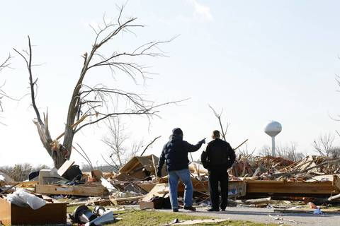 Residents and supporters survey the scene in the wake of a devastating tornado that struck Washington.