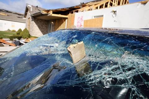 Remnants of a Sunday tornado litter Diamond Estates subdivision in Diamond, Ill., Monday morning.