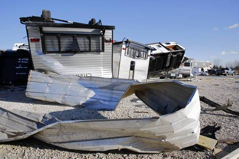 The entire lot of 75 travel trailers at E.Z. Living R.V. Sales were destroyed after being tossed and smashed by the tornado that hit Diamond, Illinois.