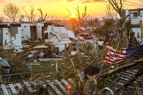 The sun rises over devastation in Washington, Ill., the morning after a strong tornado tore through the community.