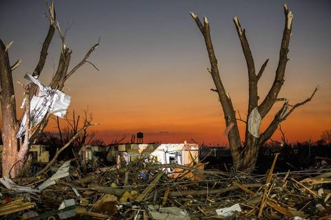 Dawn reveals the devastation of Washington, Ill., the day after a strong tornado tore through the area, leveling homes and businesses.
