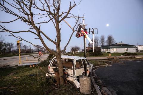 Remnants of homes and vehicles remain scattered about the community of Washington, Ill., the day after a strong tornado swept through the town.