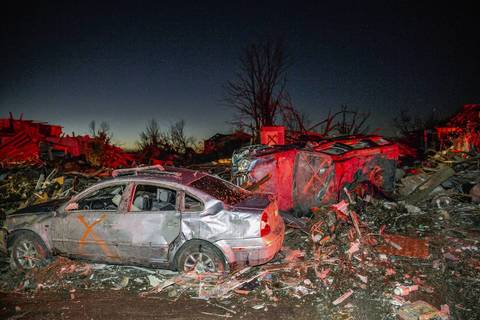 """Tornado-damaged homes and cars that have been searched for storm victims are marked with an """"X"""" along Devonshire Road in Washington, Illinois."""