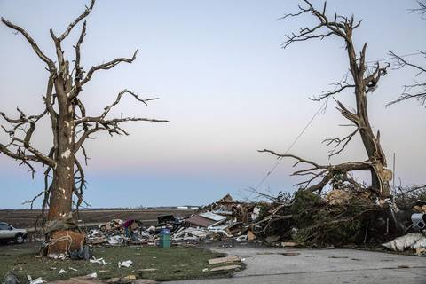 The remains of the home belonging to Lindsay and Ben Dubois on North Main Street in Washington, Ill., sits in ruins after a tornado swept through the area earlier in the day.