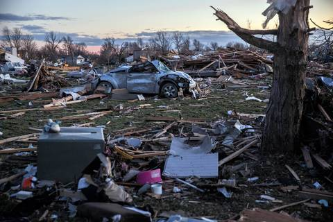 Cars, houses and trees are a tangled mess along Devonshire Road in Washington, Ill., after a tornado tore through the area.
