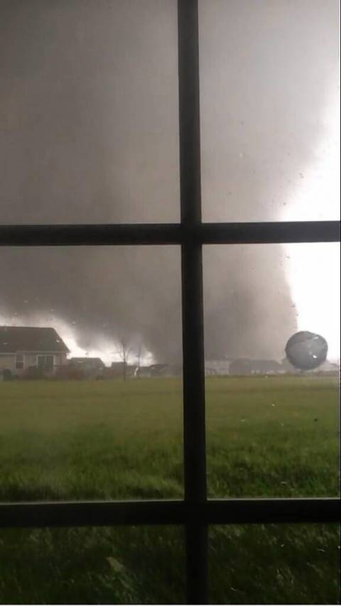 "From CNN iReport: ""Anthony Khoury says he and his family were in their home in Washington, Illinois, when his father thought he heard a helicopter flying overhead. Khoury and his parents turned to look out the window only to see a tornado barreling through their neighborhood."""
