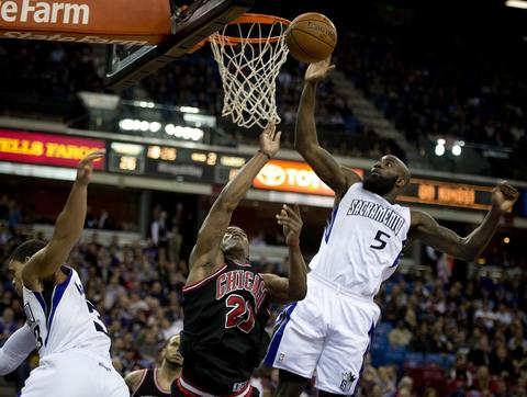The Kings' Quincy Acy blocks the shot of Jimmy Butler, who was fouled by Ray McCallum during the first quarter.