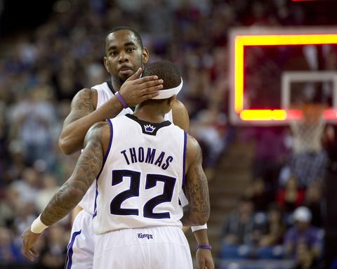 The Kings' Isaiah Thomas is embraced by Marcus Thornton after scoring two points at the end of the second quarter.