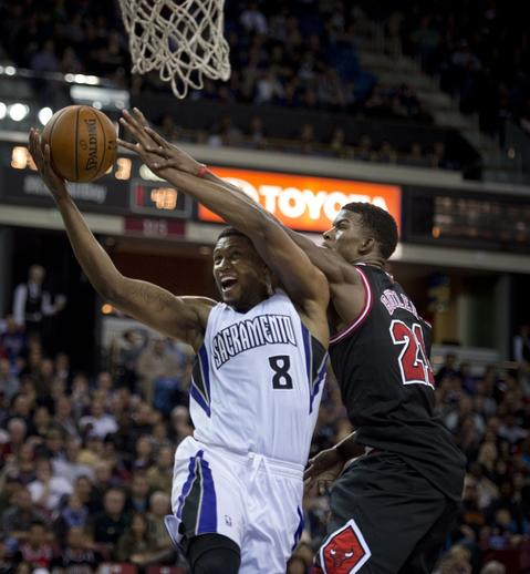 The Kings' Rudy Gay is fouled by Jimmy Butler as he drives to the basket in the third quarter.