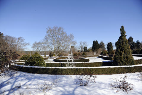 Evergreens, hedges, stone and obelisks provide plenty to look at in the winter in Alice Ryan's garden in Easton.