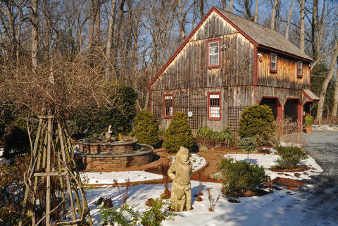 "The perennial garden and replica barn at Chris Killian's Annapolis home are attractive in winter, due to many structural elements and varied materials. At left is a wooden obelisk to support a native honeysuckle. Pierre and Nancy Moitrier of ""Designs for Greener Gardens"" in Annapolis helped create its current design."