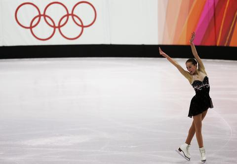 Kimmie Meissner performs during the women's short program at the 2006 Olympics.
