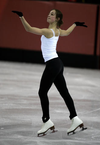 Kimmie Meissner practices at the Palavela ice rink in Turin, Italy.