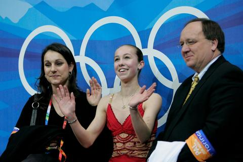 Kimmie Meissner listens to the judges' scores after skating.