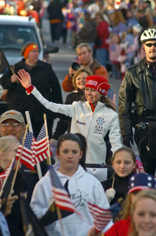 Kimmie Meissner waves to the crowd during a parade to honor her on Main Street in downtown Bel Air after she returned from the Olympics.