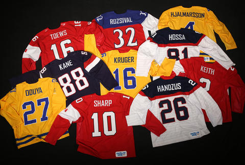 The sweaters of the ten Olympian Blackhawks.