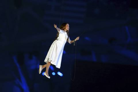 Liza Temnikova, as Lyubov, performs during the Opening Ceremony of the Sochi 2014 Winter Olympics.