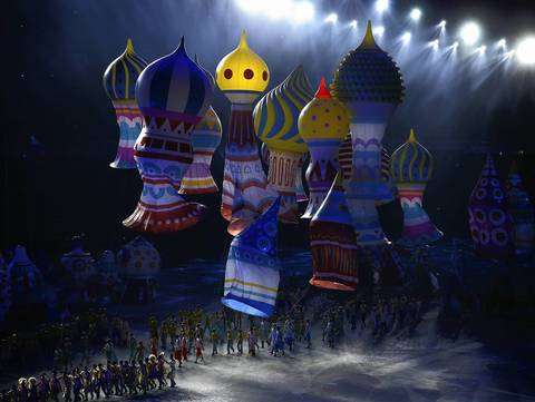 Pieces of a cathedral float to the floor of the opening ceremony of the Sochi 2014 Winter Olympics.