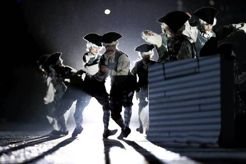 Actors perform as characters from the time of Peter the Great during the Opening Ceremony.