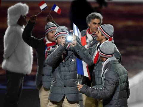 Members of France's Olympic team record the moment during the Opening Ceremony