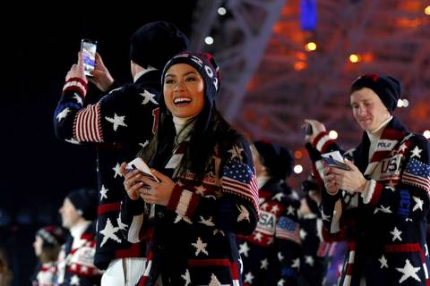 Figure skater Madison Chock parades the stadium with the United States Olympic team during the Opening Ceremony.