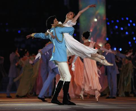 Dancers Danila Korsuntsev and Svetlana Zakharova perform during the opening ceremony of the Sochi 2014 Winter Olympics.