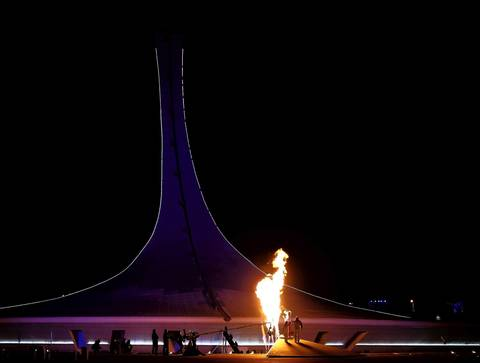 Irina Rodnina and Vladislav Tretyak light the Olympic cauldron during the opening ceremony of the 2014 Winter Olympics.