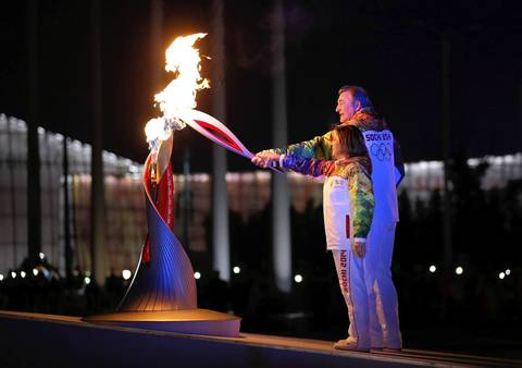 Irina Rodnina and Vladislav Tretyak light the Olympic cauldron during the opening ceremony.