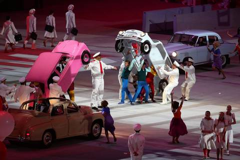 Scenes from Russia's Soviet past are performed during the opening ceremony for the Winter Olympics