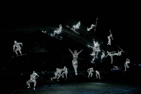 A universe of athletic stars sparkles inside Fisht Olympic Stadium during the opening ceremony for the Winter Olympics.