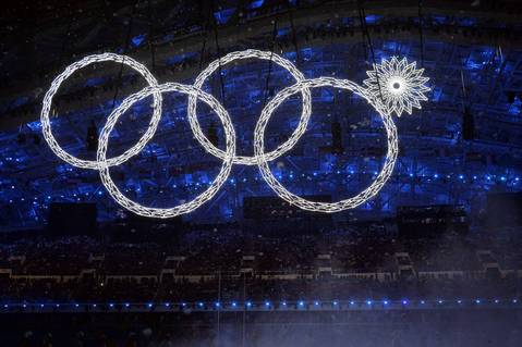 The Olympic rings are created by snowflakes during the Opening Ceremony of the Sochi Winter Olympics.