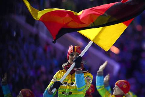 Germany's flag bearer, alpine skier Maria Hoefl-Riesch, leads her national delegation during the opening ceremony.
