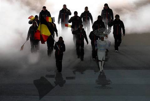 Belgium's flag bearer, bobsledder Hanna Emilie Marien leads her delegation during the Opening Ceremony of the Sochi Winter Olympics.