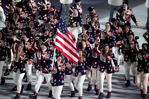 The United States team enters Fisht Olympic Stadium during the opening ceremony of the Winter Olympics.
