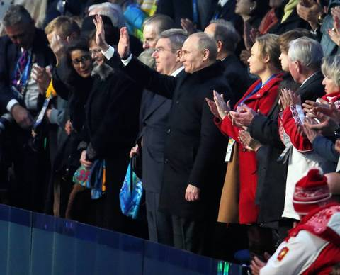 Russian President Vladimir Putin waves during the pening ceremony for the Winter Olympics.