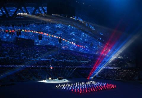 Performers in red, white and blue illuminated costumes form the Russian national flag during the opening ceremony.