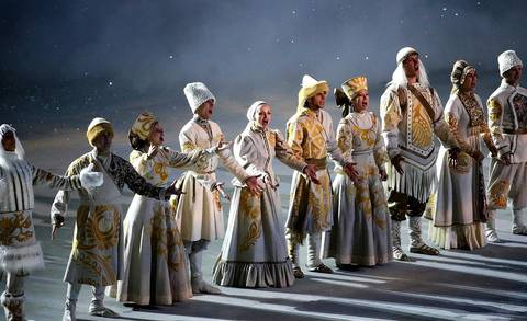 Performers in traditional Russian costumes perform during the opening ceremony for the Winter Olympics.
