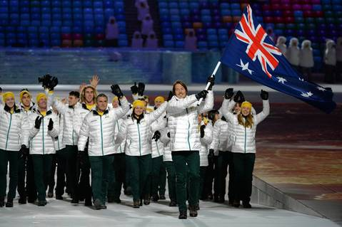 Australia's flag bearer, snowboarder Alex Pullin leads his national delegation during the Opening Ceremony of the Sochi Winter Olympics.