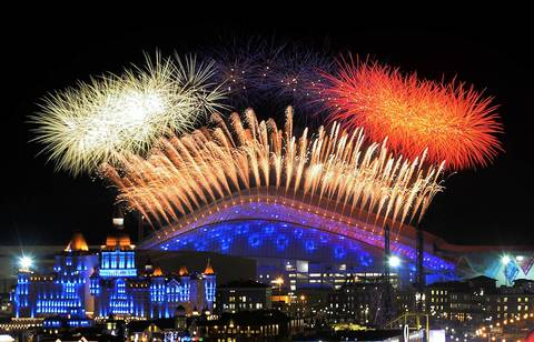 Fireworks explode over the Fisht Olympic Stadium at the begining of the Opening Ceremony of the Sochi Winter Olympics
