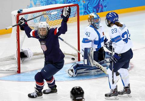 U.S. forward Hilary Knight (21) scores a goal against Finland goaltender Noora Raty (41) during the first period in a women's hockey game.