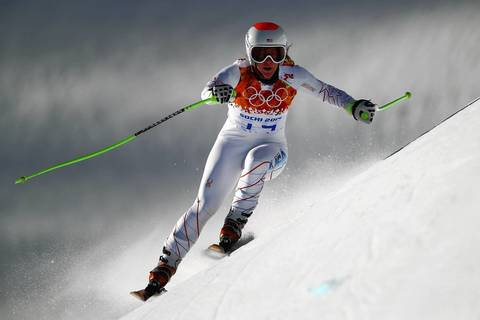 U.S. skier Julia Mancuso rounds a hill during training for the Alpine skiing women's downhill.