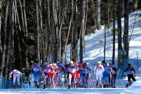 Skiers compete in the women's cross-country skiing skiathlon at the Laura Cross-Country Ski and Biathlon Center.