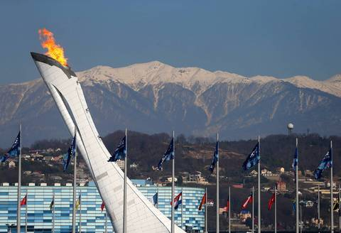 The Olympic torch burns bright at the Winter Olympics in Sochi, Russia, the morning after the opening ceremony.