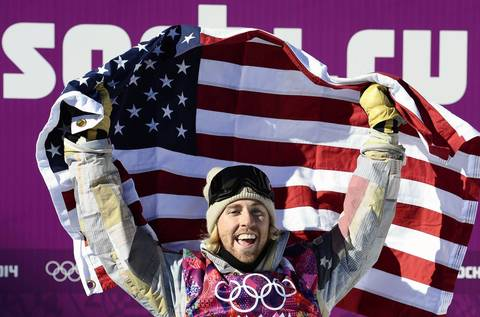 U.S. snowboarder Sage Kotsenburg celebrates his Gold Medal at the end of the men's snowboard slopestyle final at the Rosa Khutor Extreme Park.