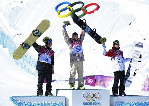 Silver medalist Staale Sandbech of Norway, gold medalist Sage Kotsenburg of the United States and bronze medalist Mark McMorris of Canada pose on the podium during the flower ceremony following the men's snowboard slopestyle final.