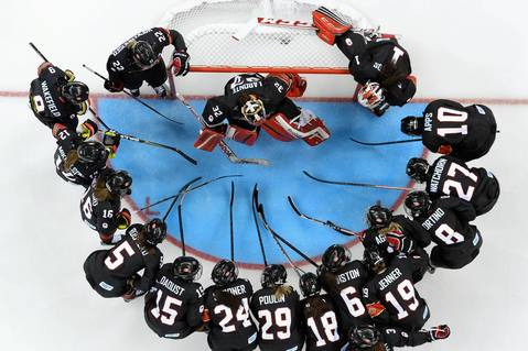 Team Canada gather before the start of the women's hockey match against Switzerland at the Shayba Arena.