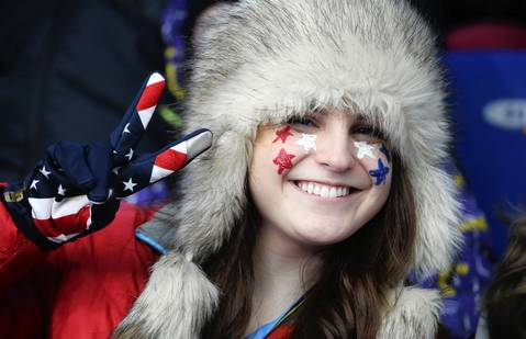 A young girl watch the first day of competition in the men's singles luge at the Sanki Sliding Center.