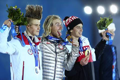 (L-R) Silver medalist Staale Sandbech, of Norway, gold medalist Sage Kotsenburg, of the U.S. and bronze medalist Mark McMorris, of Canada, celebrate on the podium during their medal ceremony for the men's slopestyle snowboard competition at Medals Plaza.