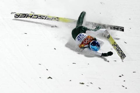 Robert Kranjec (SLO) crashes in the men's normal hill individual qualifying round at RusSki Gorki Ski Jumping Center.
