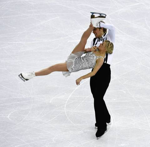 Penny Coomes and Nicholas Buckland of Great Britain perform in the team ice dance short dance program at Iceberg Skating Palace.